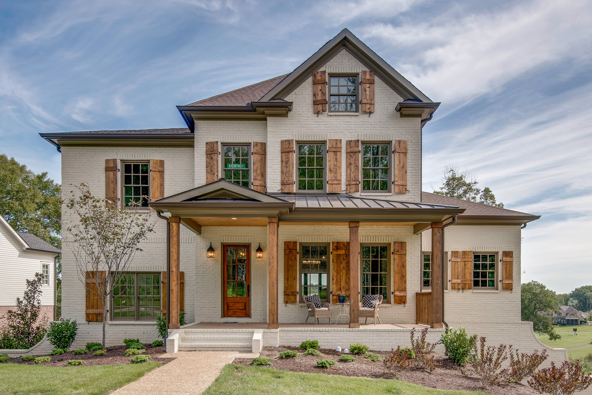 Three-story Painted Brick Custom Home